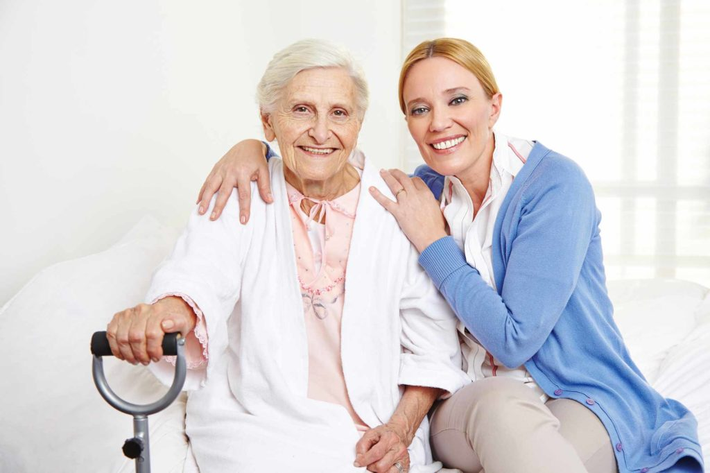 Elderly Woman And Caregiver At Skilled Nursing Facility