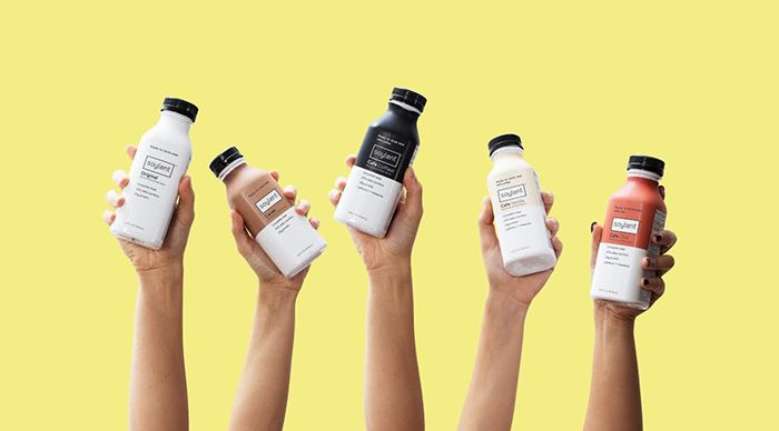 people holding Soylent Meal Replacement Drink