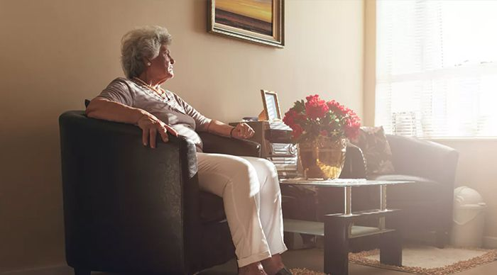 elderly sitting down on couch Amazon Echo