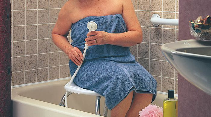 Senior using shower chair / bath bench carex shower chair