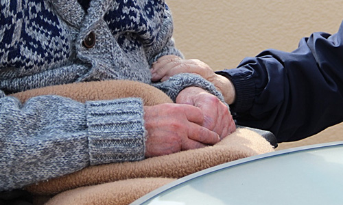 Two Elderly comforting each other